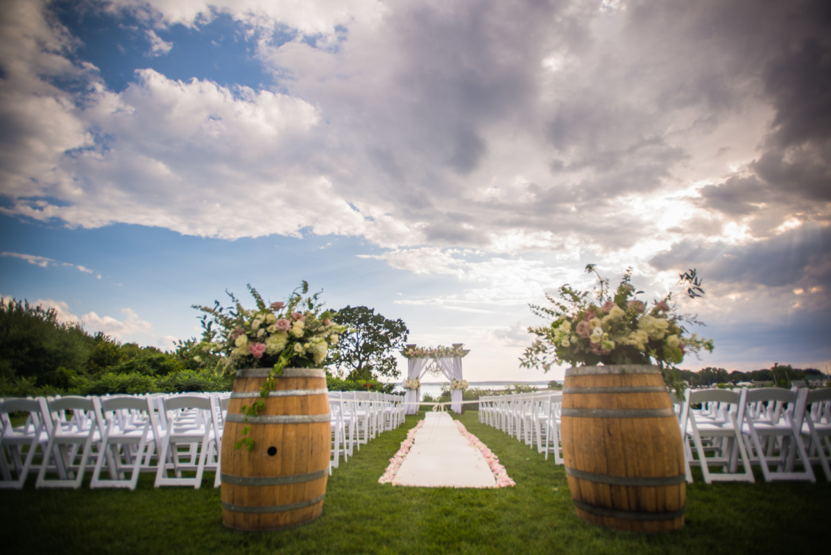 Wedding chairs set up with a blue sky.
